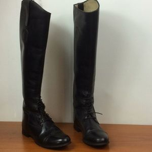 Elan tall black leather riding boots.